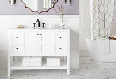 Bathroom with a white vanity and a soaking tub