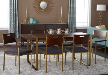 Metallic glam dining set with candles on an area rug