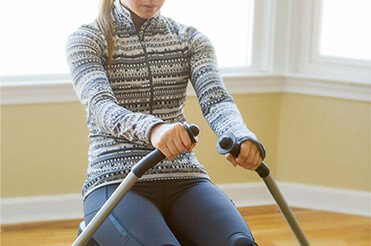 Woman using a rowing machine in a living room