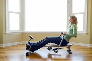 Woman using a rowing machine