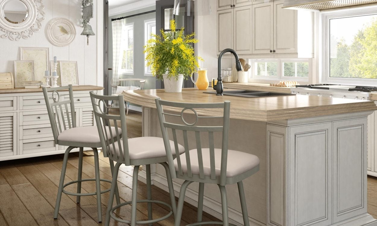 Three white bar stools in kitchen