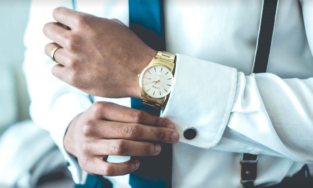 Man in suit wearing gold watch