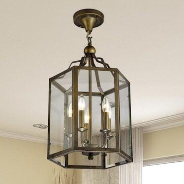 Sem-flush mount lantern-style light handing from a ceiling