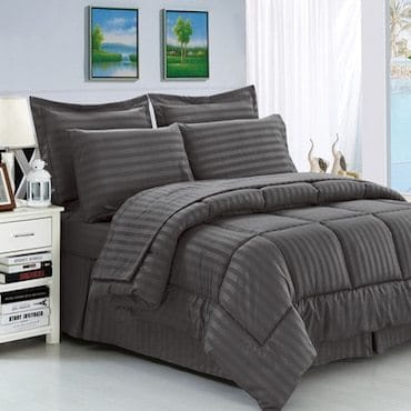 grey alternative down pillows on grey bed