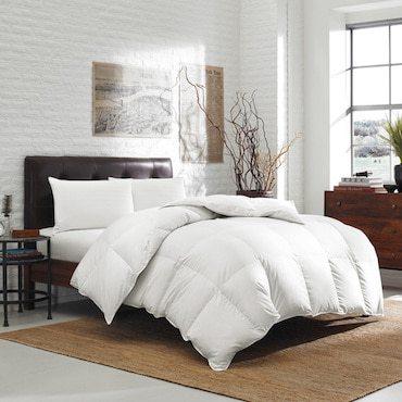 white down alternative pillows on a dark brown bed