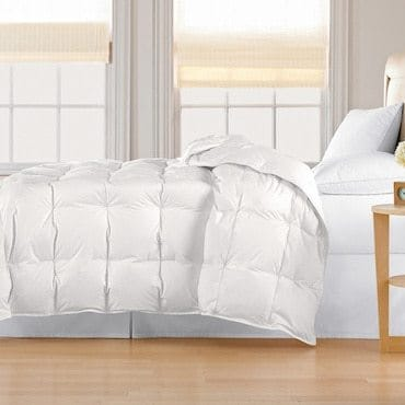 Bed with white down comforter