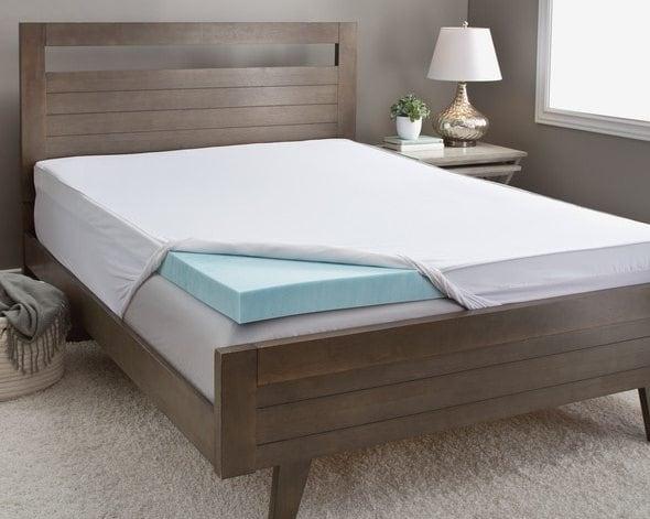 Brown mid-century modern bed with blue gel memory foam mattress topper