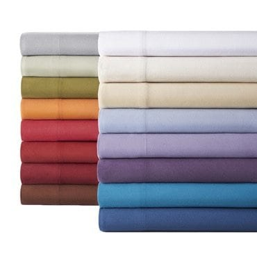 A stack of flannel sheets in a variety of colors and patterns