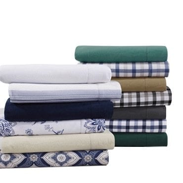 A stack of flannel sheets in variety of patterns