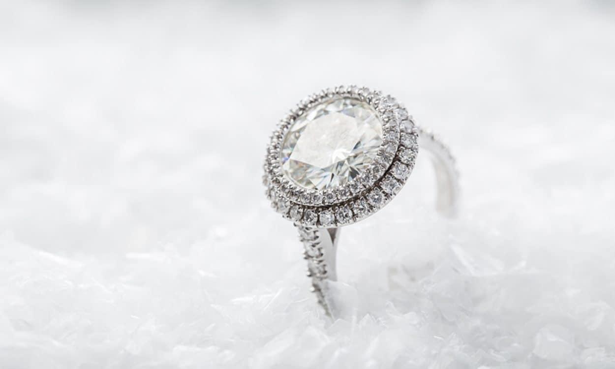 round-cut diamond halo ring on white background
