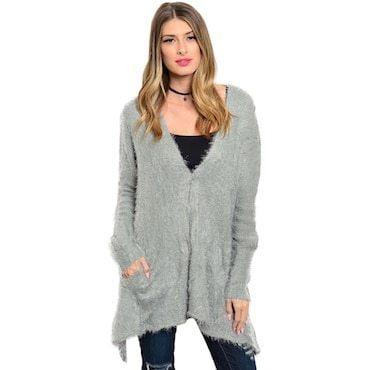 woman wearing long grey sweater over black leggings