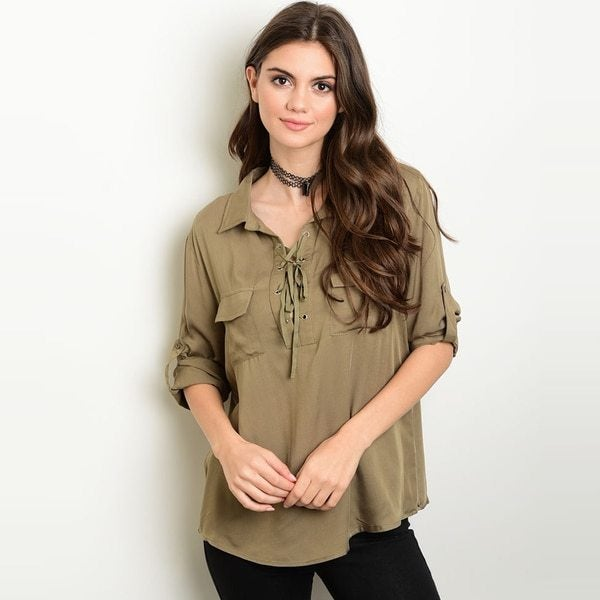 woman wearing olive shirt over black leggings