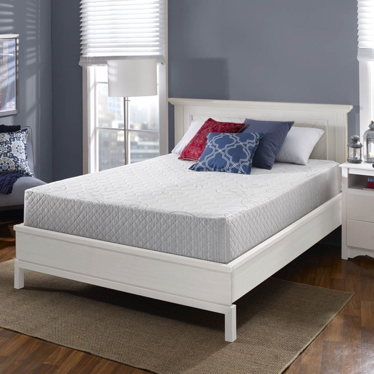white bedframe with grey memory foam mattress