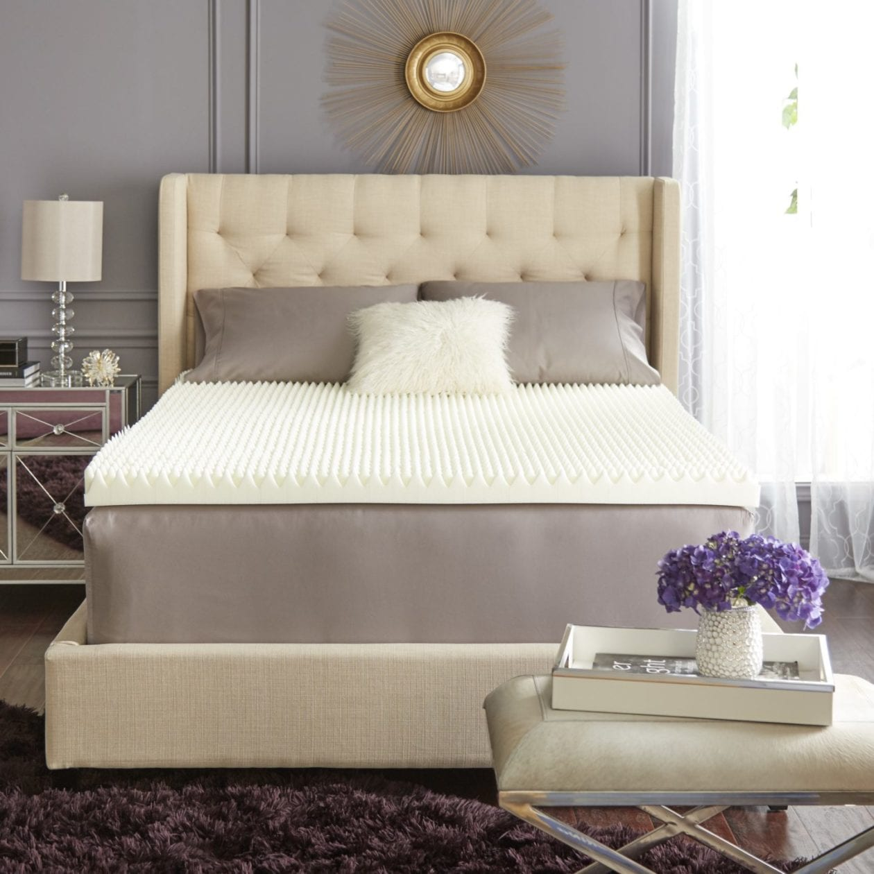 white tufted bed frame with memory foam topper