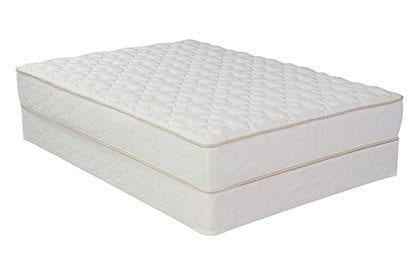A mattress with a built in box spring on the bottom