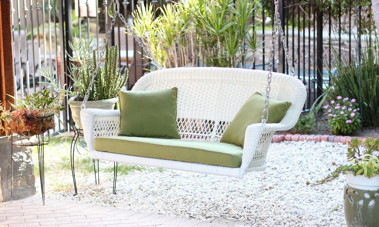 White Porch Swing With Green Cushions