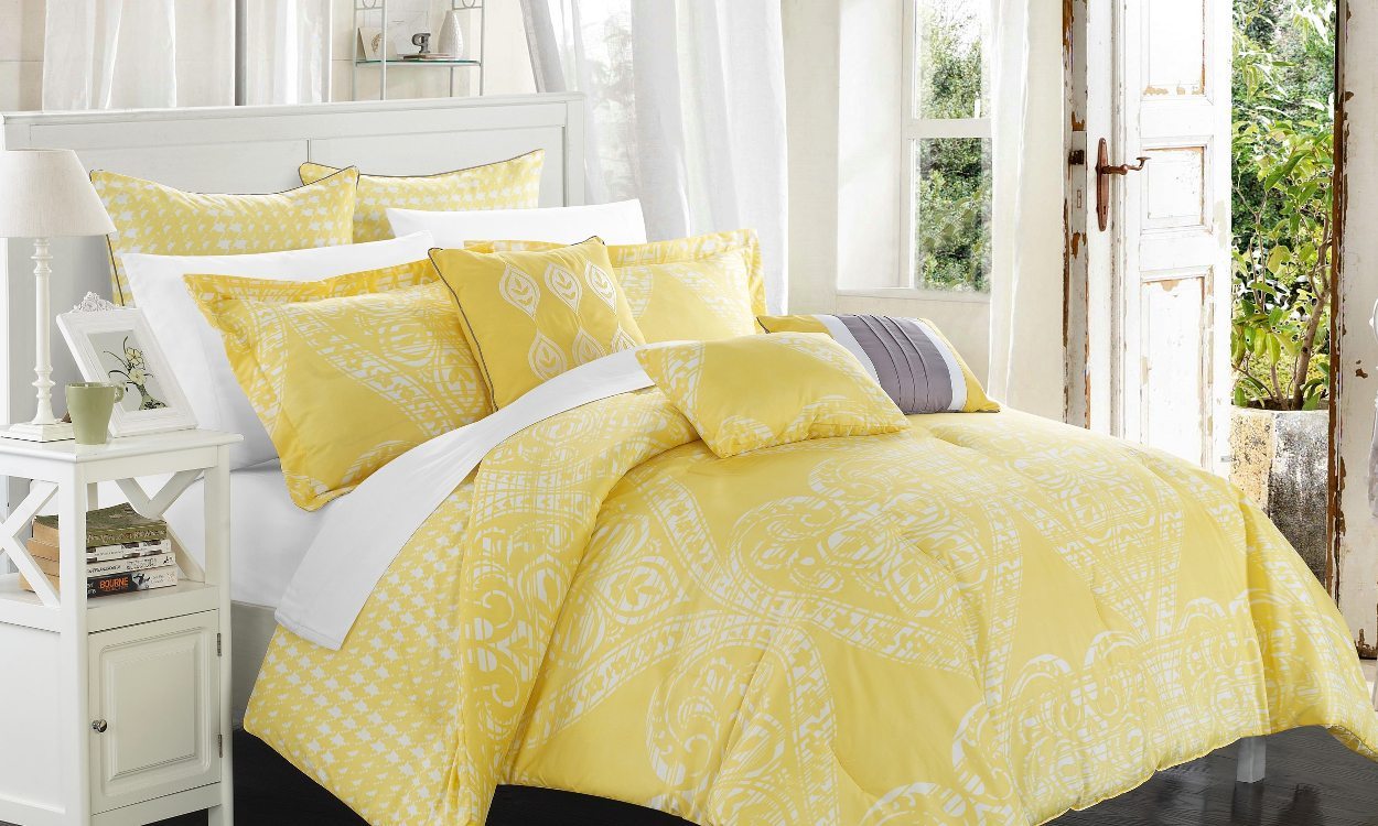 Yellow comforter set on bed