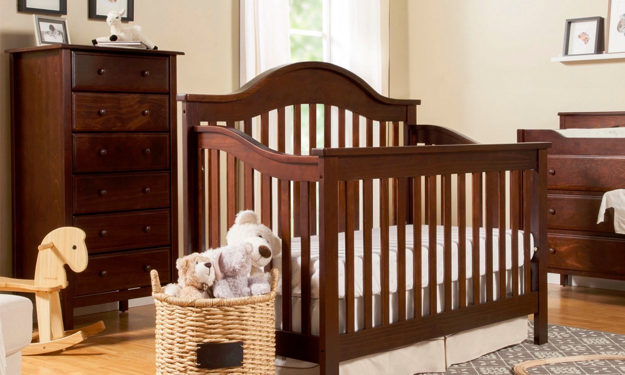 Baby nursery with crib, dresser, and changing table