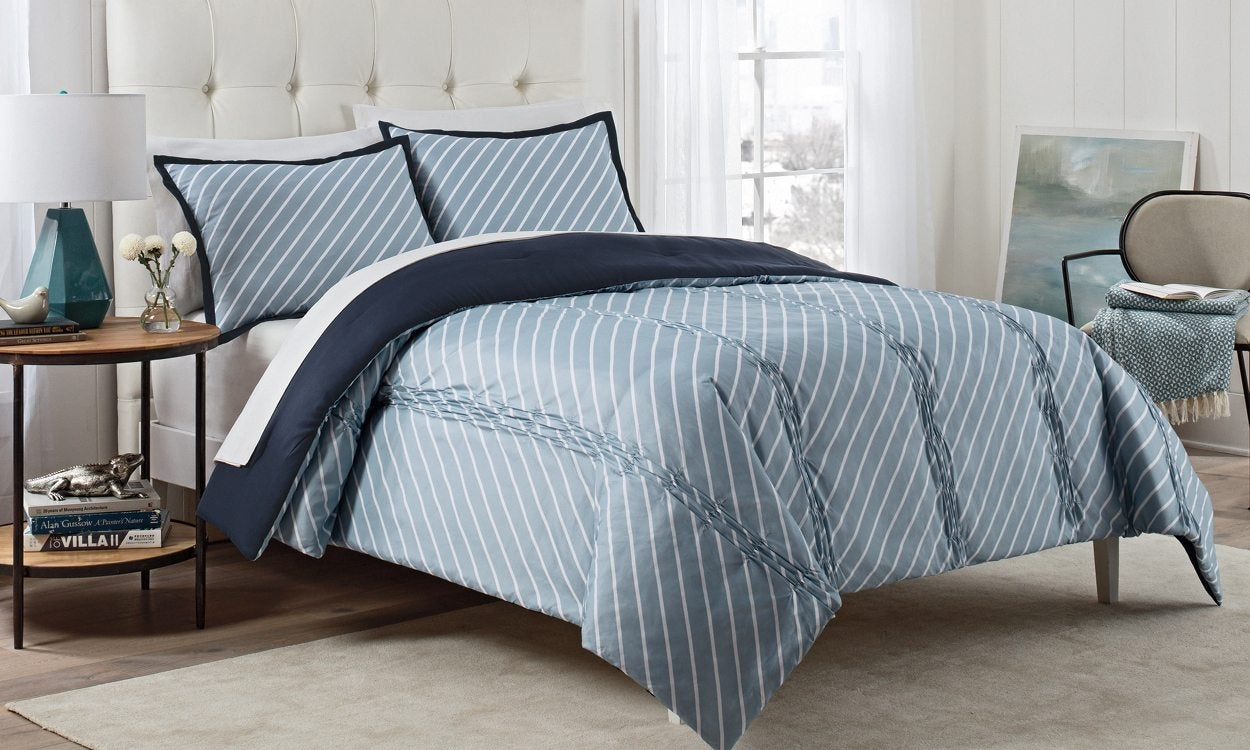 Navy bedspread on bed - International Bedding Size Conversion