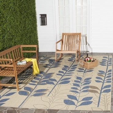 Blue and light brown outdoor area rug
