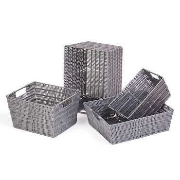 Grey wicker storage baskets