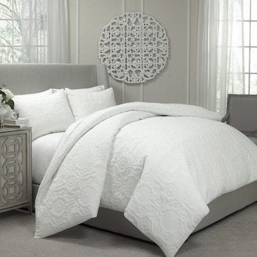 White quilt on a bed