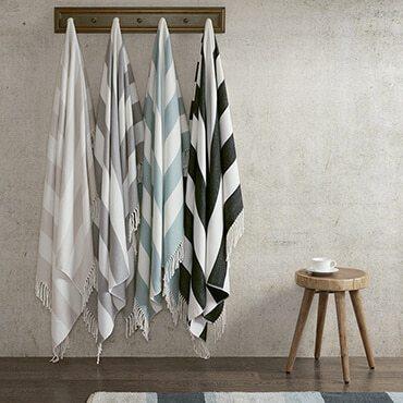 Acrylic blankets hanging on hooks