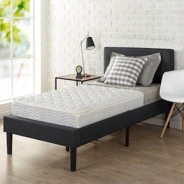 kids mattress on a bed frame