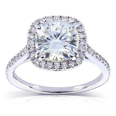 Cushion cut moissanite center stone, and diamond halo