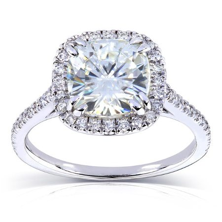 Cushion cut moissanite center stone, and diamond halo