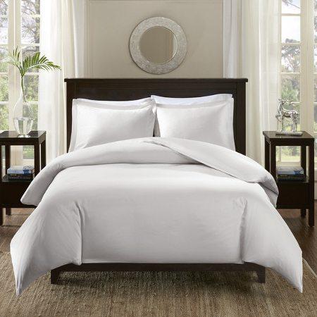 Bed with plain white Egyptian cotton bedding set