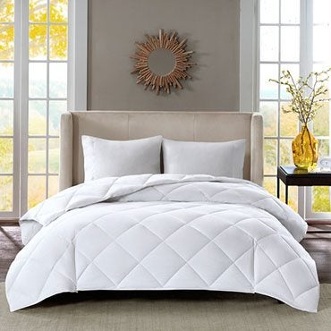 bed with down-alternative comforter