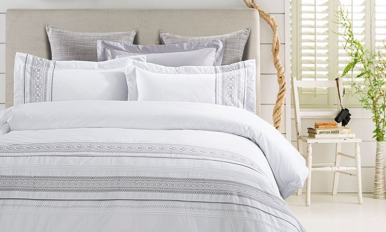 White duvet cover on bed with pillows