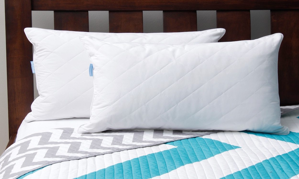 Two white down pillows on a bed