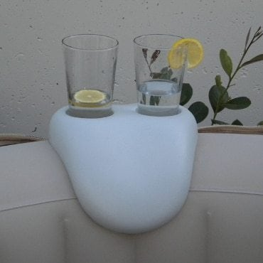 glasses of lemonade by a hot tub