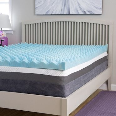 Memory foam topper on a mattress