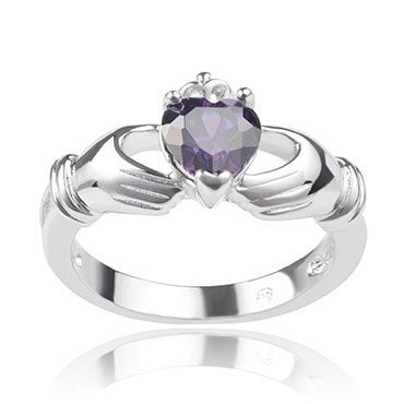 A Claddgh ring with a purple gemstone in the center