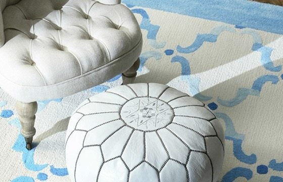 A white leather boho floor pouf