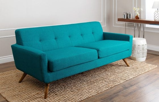 A bright turquoise boho sofa
