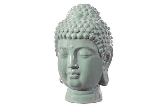 A boho buddah head statue