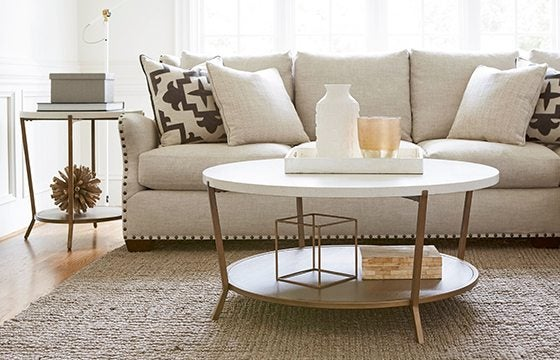 White linen sofa with round coffee table new home essentials