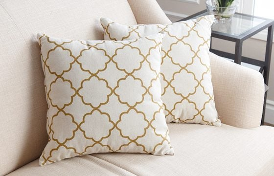 two white and yellow trellis patterned throw pillows new home essentials