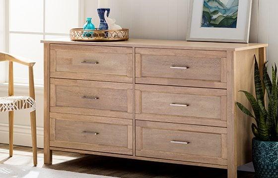 light brown wooden mid-century style dresser new home essentials