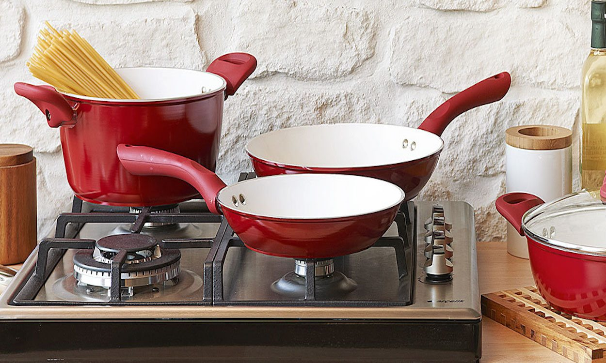 red cookware on a stove