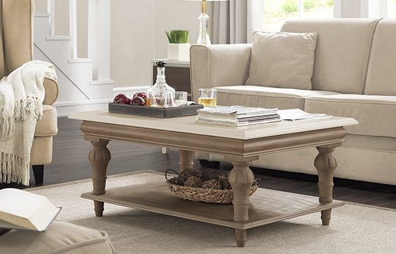 white linen couch with wooden coffee table new home essentials