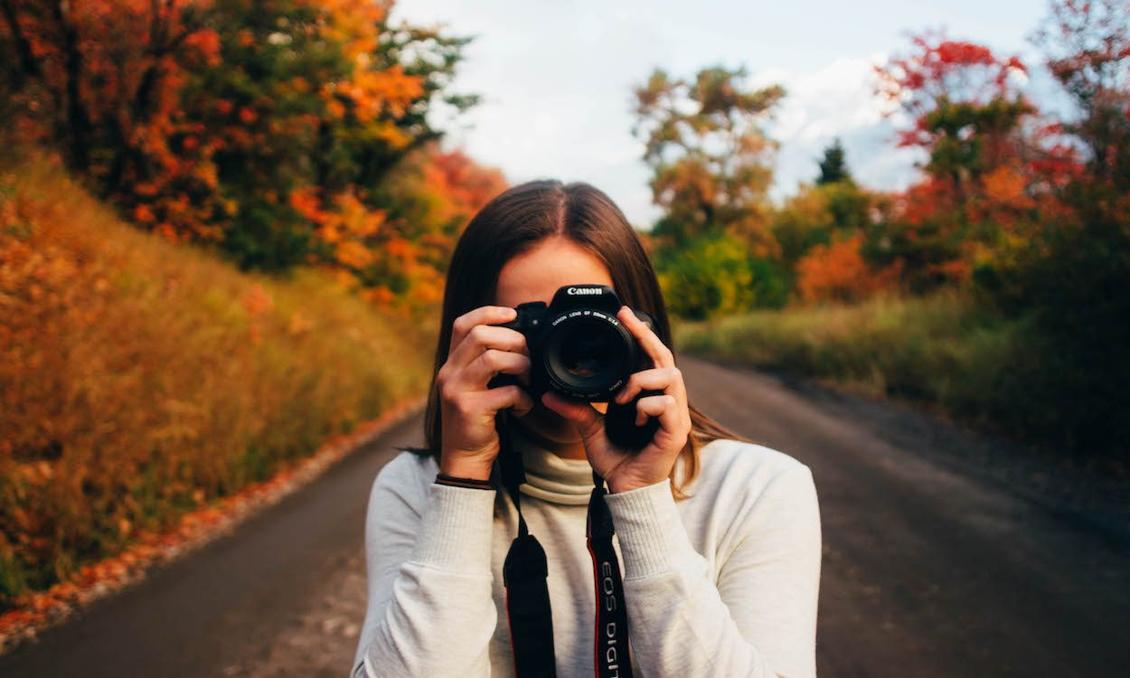 a woman taking a picture