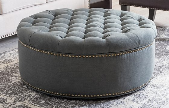 grey, round, upholstered ottoman new home essentials