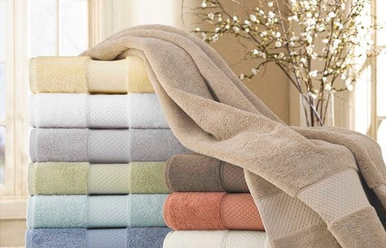 stack of multi-colored towels new home essentials