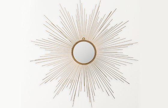 round mirror in a gold sunburst frame new home essentials