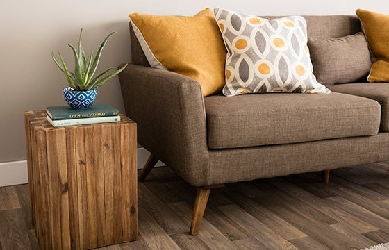 brown tweed sofa with bright yellow pillow Mid-Century Modern Living Room Ideas